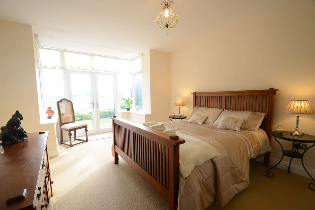 The large Master Bedroom has a King Size bed, stunning views and a full En Suite with Bath and shower.