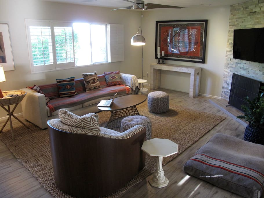 Comfortable living room seating for enjoying the home theater with surround sound.