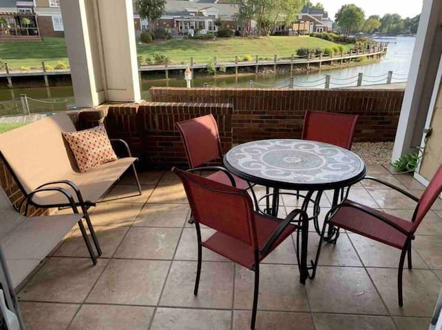 Walk directly from the first floor patio to the lakeside boardwalk, private marina with included boat slip
