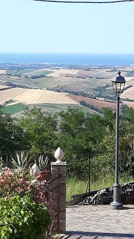 big house on the hills next to Mondaino