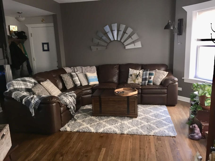 Very comfortable leather sectional, each end is a recliner.  Countless throw pillows and comfy blanks make for a great night in watching you favorite show/movie or curl up with a great book!
