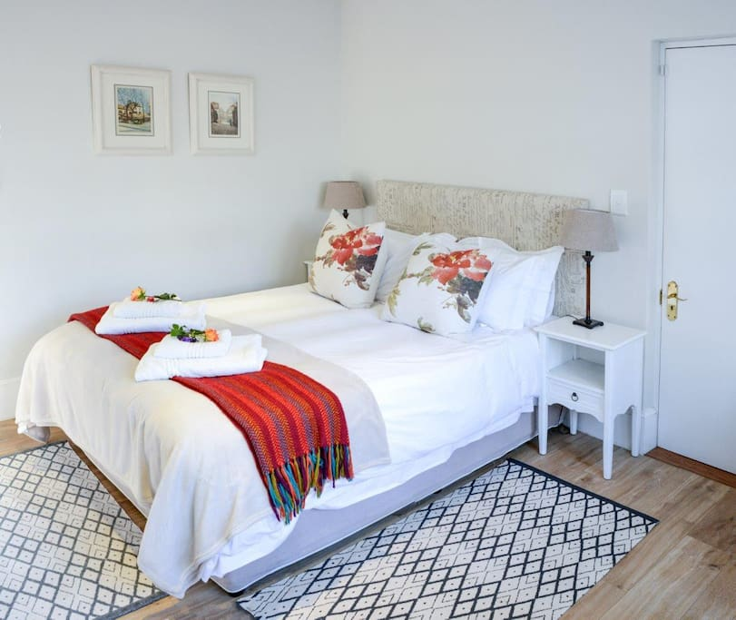 The comfy queen size bed has fresh cotton linen
