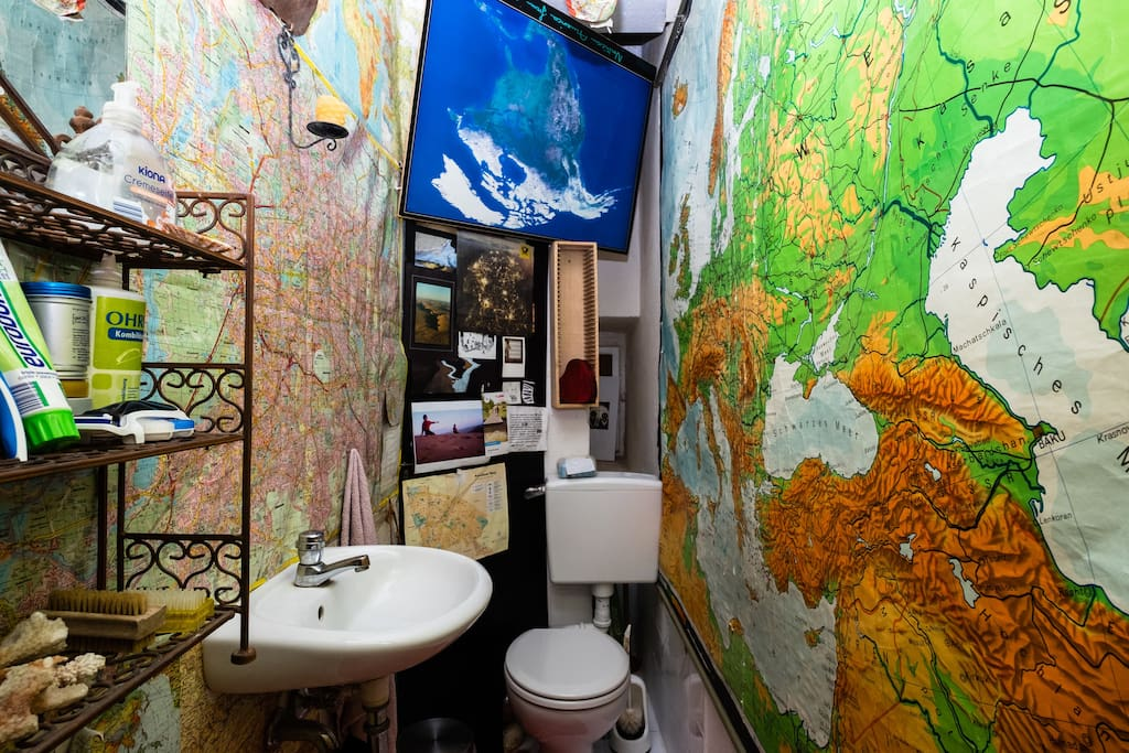 berlin and the world on the walls in the bathroom