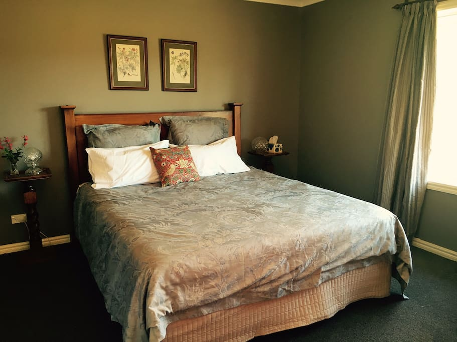 There is a comfortable king size bed,  complete with high quality cotton sheets, bedside cabinets and lamps.