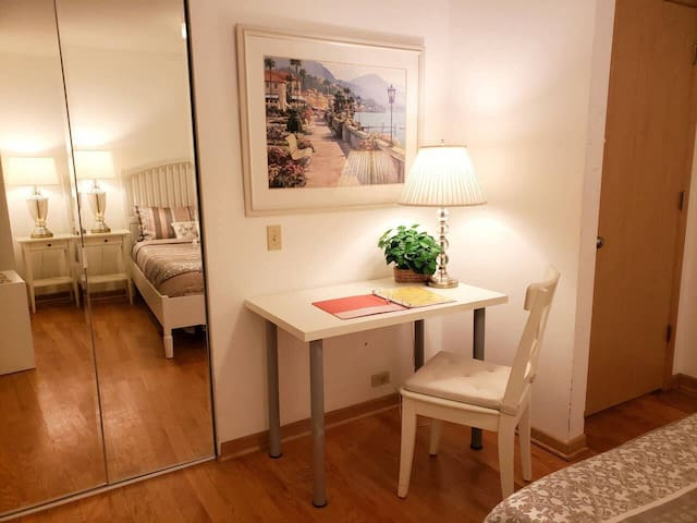 There is a full-sized mirror and a desk in your room!