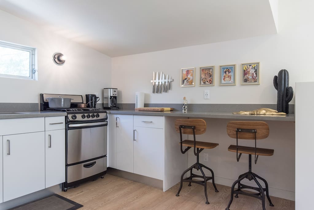 This kitchen is perfect to cook in and has a seating area to dine or check your emails.