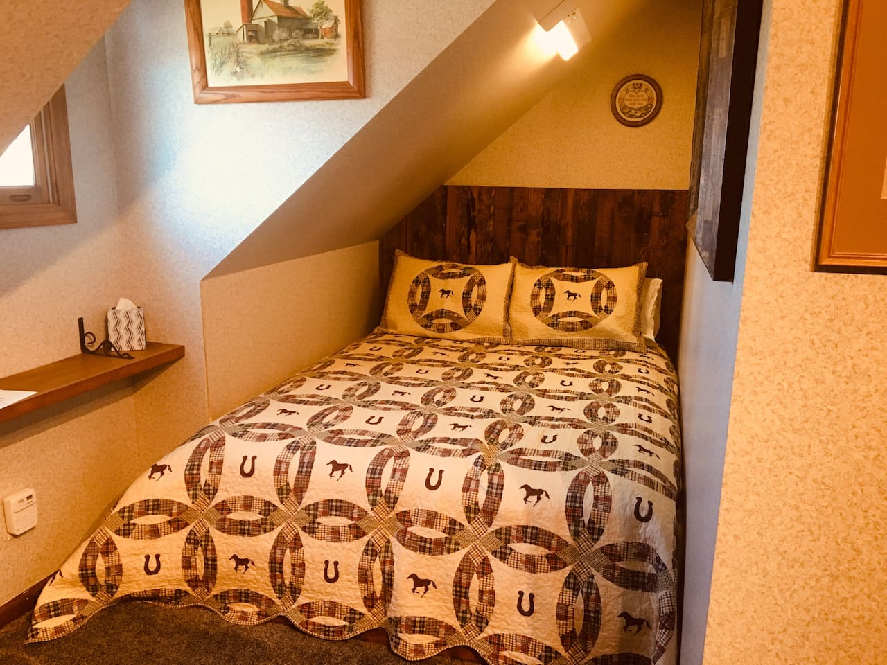 We built in a queen bed  so that this room could have it's own bathroom.  It has a nice walk in tiled shower, heated tile floor, corner toilet and pedestal sink.