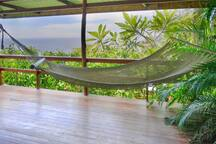 Relax on your private porch in this hand woven Tico hammock and listen to the waves crashing below :)