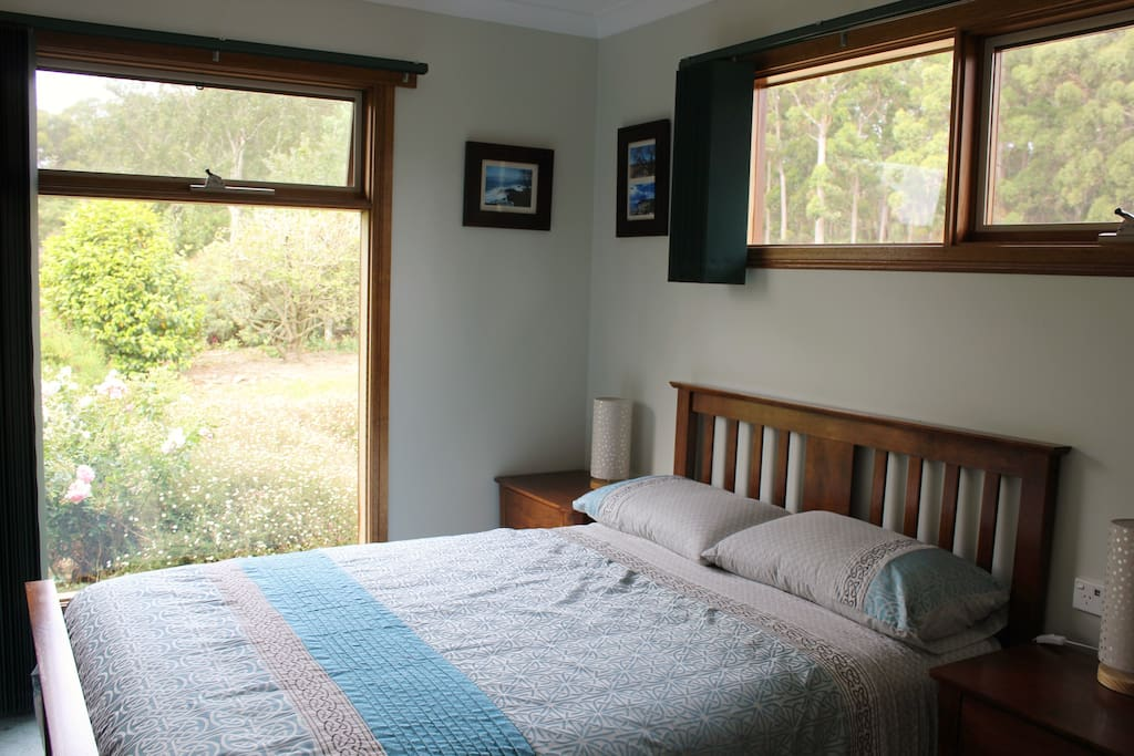 The double room looks out over the NE garden, through the trees to Bass Strait
