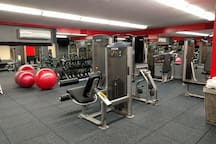 The Fitness Center is equipped with weight machines, treadmills, and free weights.