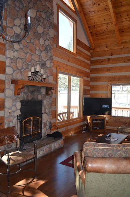 Enjoy family time around the stone fireplace.