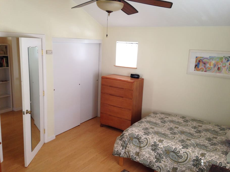Guest bedroom dresser and closet with hangers