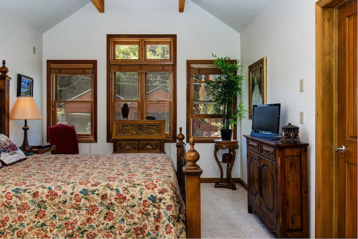 Gorgeous wood beams and large windows set off the master bedroom.