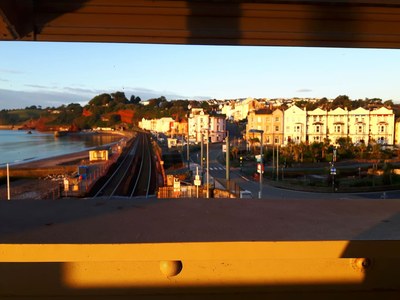 On the row of Town Houses, my appartment is on the top floor of the last building on the right with the red coving... right opposite Dawlish train station AND THE BEACH!!!