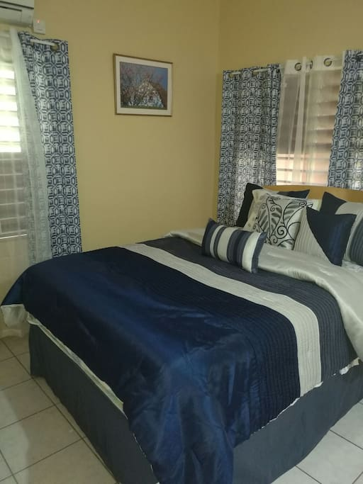 Large Air Conditioned Bedroom with a Queen sized bed.