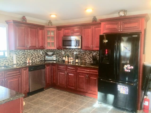 Kitchen is Updated with plenty Kitchen Utensils and cooking Supplies. Stocked with Seasonings . Great Space to do alot of cooking for guest.
