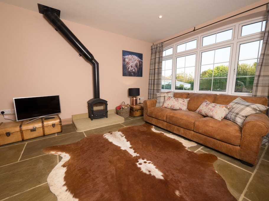 Comfortable seating area with leather seats and a cow hide rug.