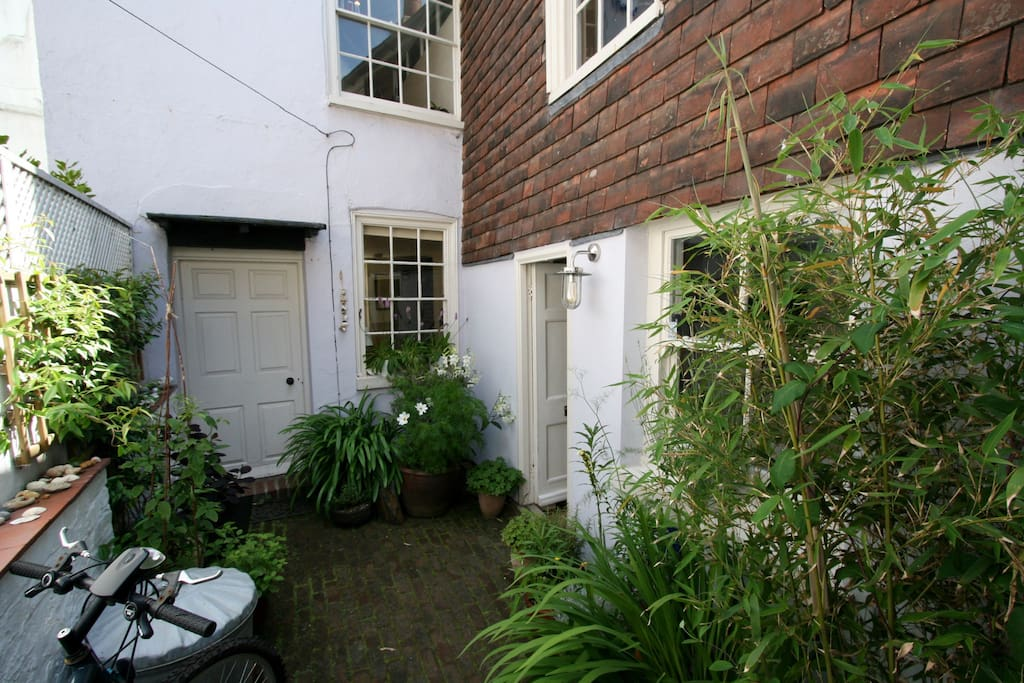 Accessible from a beautiful oasis courtyard garden