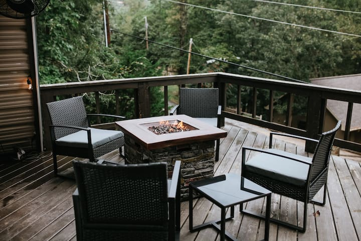 "Large front deck with seasonal views of Beaver Lake across the street.  ""The fire pit on the deck was amazing and having access to the kayaks for Beaver Lake was a great addition...so quiet and serene and wild life walked right by the back door. """