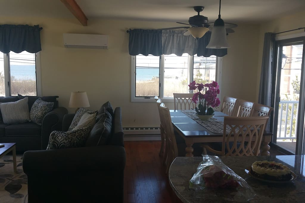 Living Room and Dining Room w/ Bay  View (Cheese Cake not included)