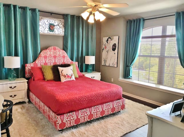 Memory foam queen bed, ample closet & drawer space and room-darkening curtains for the late-sleepers