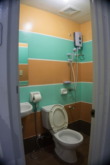 Clean Toilet and Bath with shower and heaters on every private room of Bossing Dormitel.