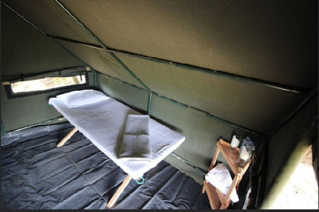 The bed room with two comfy beds to unwind after a tiring day of hiking