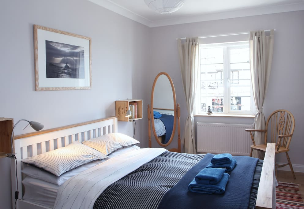 master bedroom - comfortable kingsize bed with under bed storage, drawers and hanging space