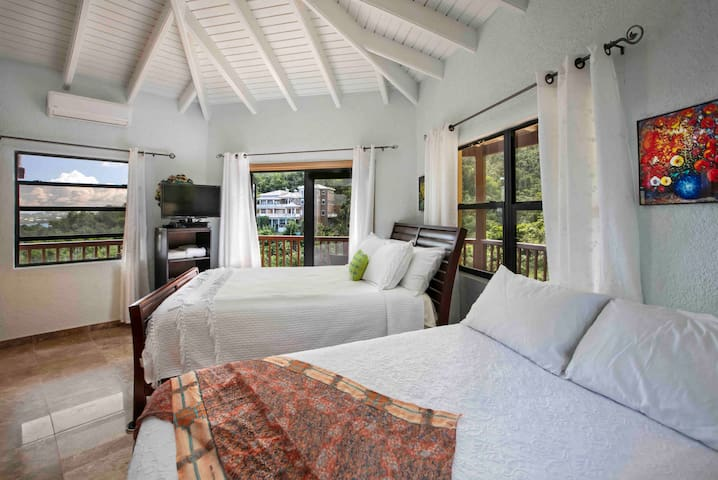 Bedroom #1.  Two beds and lots of outdoor space on the patio .  Views of Ocean