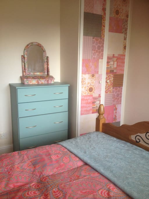 Double bedroom with chest of drawers and wardrobe