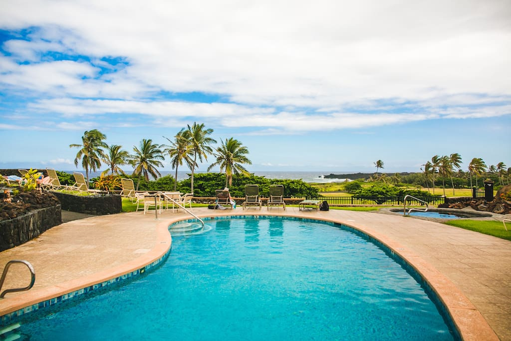 swimming pool overlooks golf course and ocean