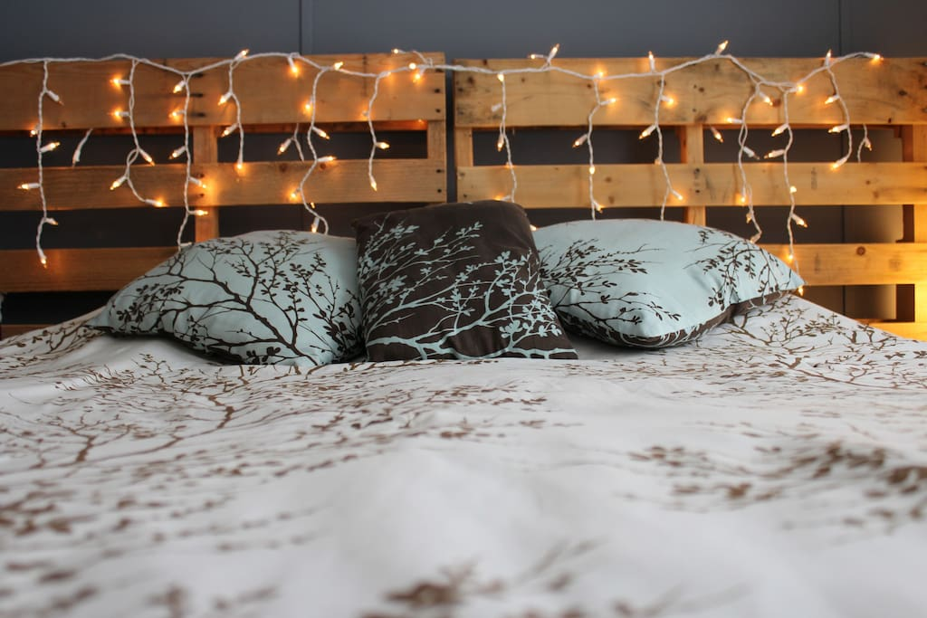 Pallet headboard with ambient lighting