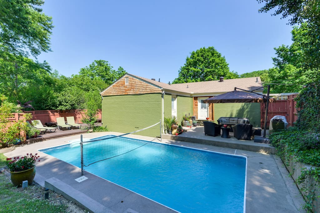 This backyard is incredible—there's a pool plus two separate furnished areas for relaxing and conversing.