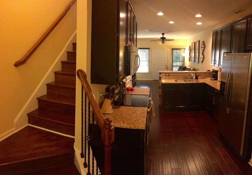 Kitchen, stairs to bedroom and loft