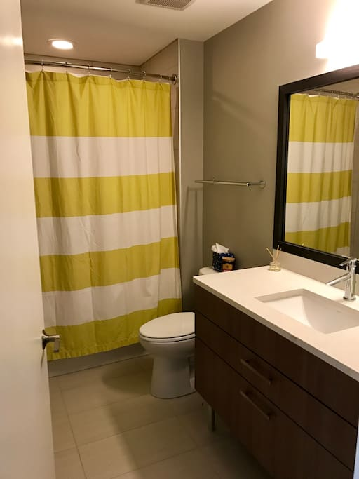 Bathroom is large with soaking tub, wide mirror, and lots of counter space. All linens will be supplied for you!