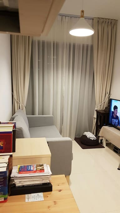 Cosy sofa with 34-inch TV