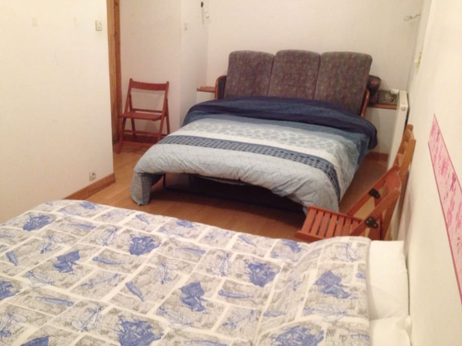 One large double bed, one small double bed, four folding chairs