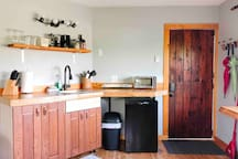 Kitchenette - equipped with two hot plates, toaster oven, mini fridge, coffee maker