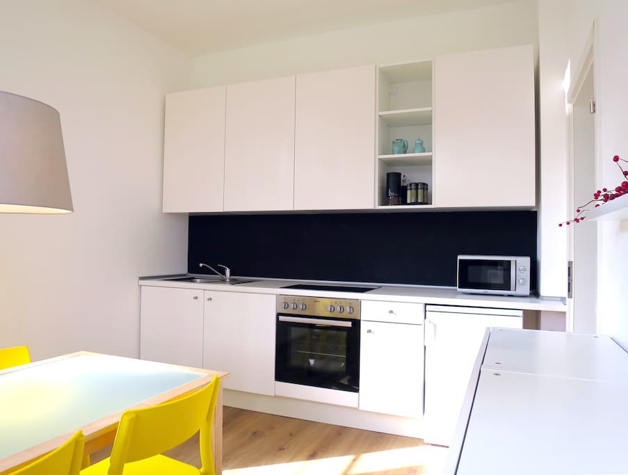 The kitchen is spacious with high ceilings and receives natural light all throughout the day. It is fully equipped with microwave, kettle, fridge, stove, oven, coffee machine.