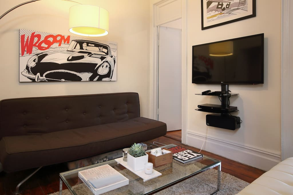Italian pop artwork acquired at a market in Montreal hangs over a BoConcept sofa.