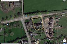 Yellow lines denote the plot and the house