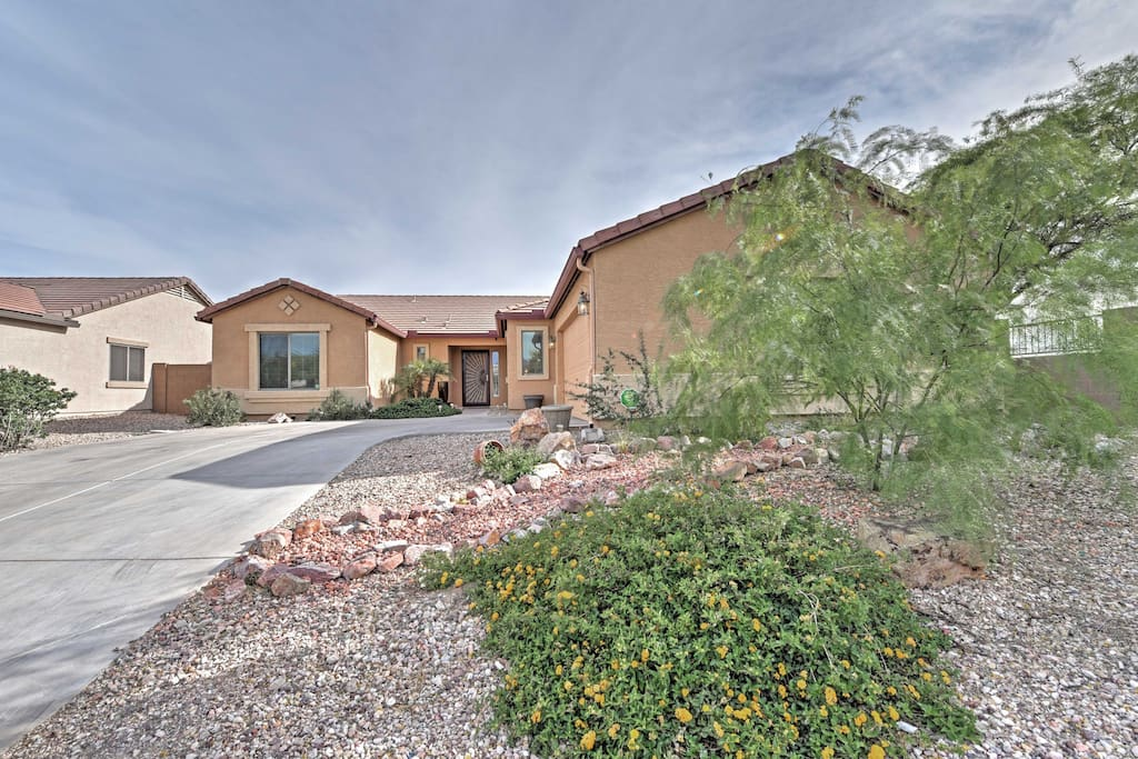 Elegant landscaping including a dry river creek bed welcomes you to the property.