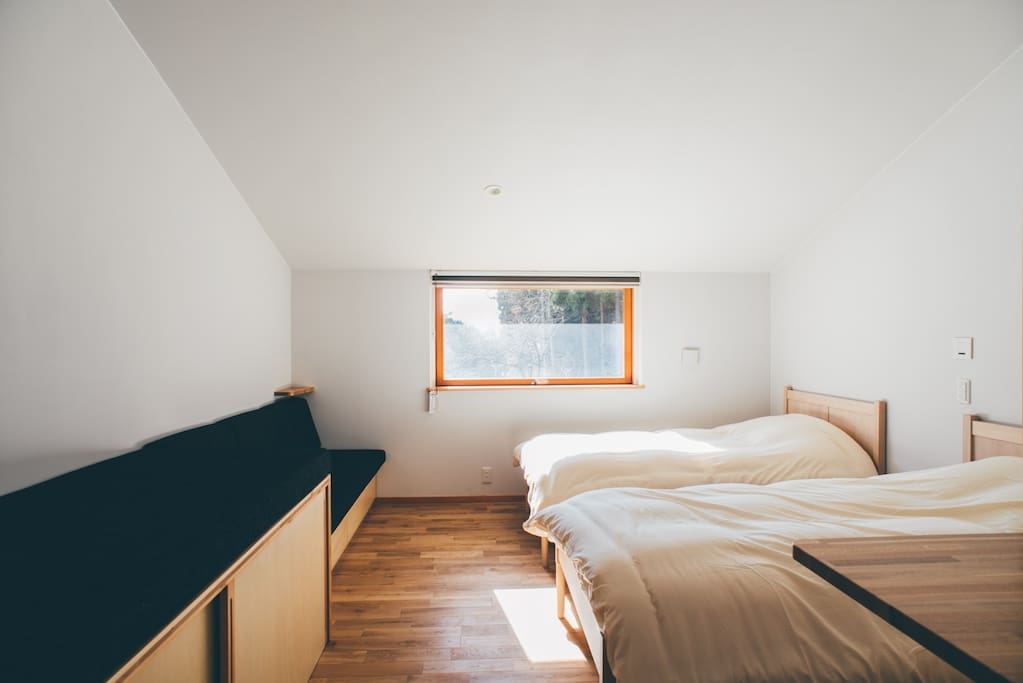 Cozy room with organic cotton linen accommodates four person