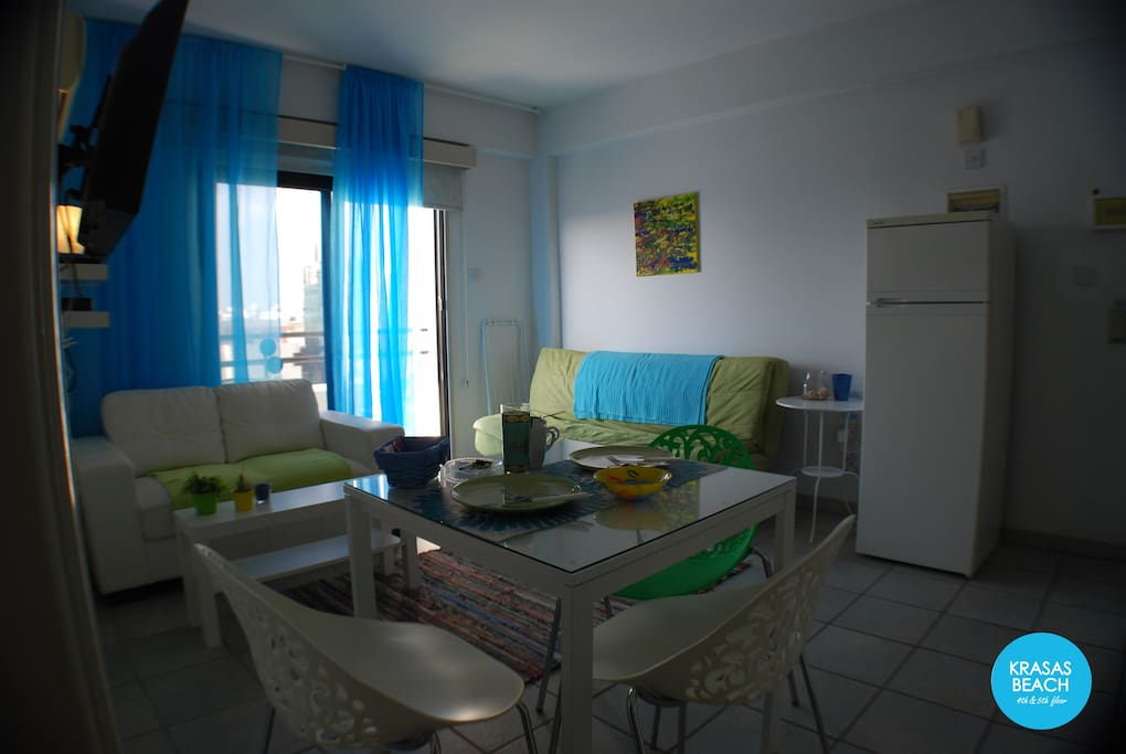 Overview of the apartment's bright dining and seating area