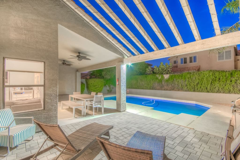 Backyard with private terrace and pergola for nice shaded area overlooking HEATED Pool.