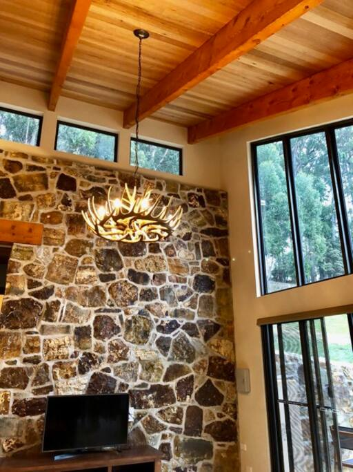 Living space with stone, wood and light