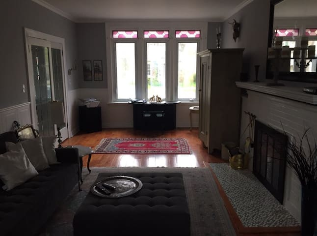 """Main floor: Relax in the great room, furnished with a structube sectional couch and ottoman, 55"""" Tv with Bell fibe cable and unlimited wireless internet."""