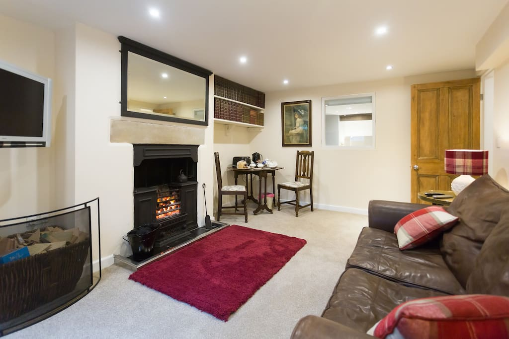 A large mirror above the fireplace, a fire guard to use when you nip out or go to bed
