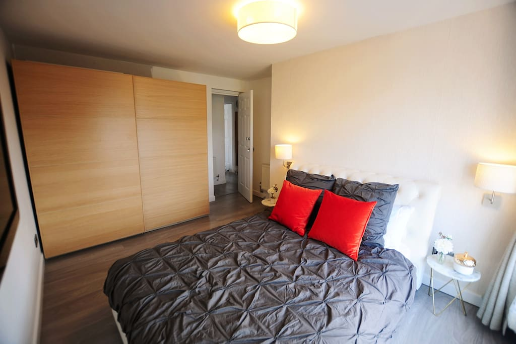 Master Bedroom - large double bed with huge wardrobe, gorgeous room with TV and view over the docks, London Excel