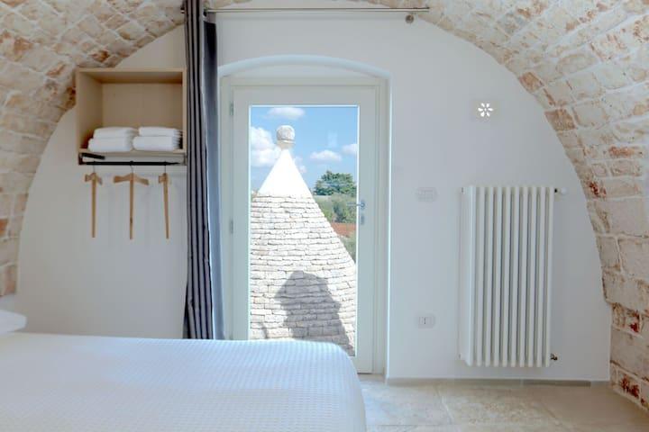 """Romantic room """"trullo view"""""""